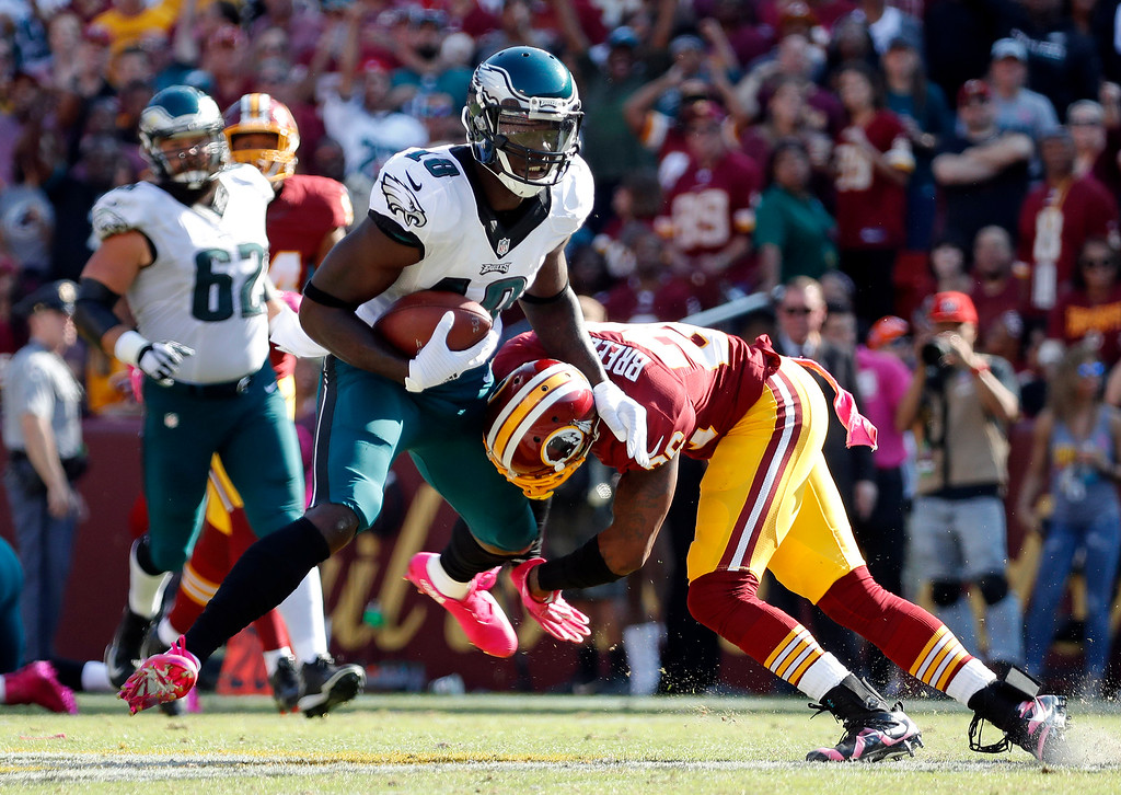 . Philadelphia Eagles wide receiver Dorial Green-Beckham, left, tries to avoid Washington Redskins cornerback Bashaud Breeland as he rushes the ball in the second half of an NFL football game, Sunday, Oct. 16, 2016, in Landover, Md. (AP Photo/Alex Brandon)