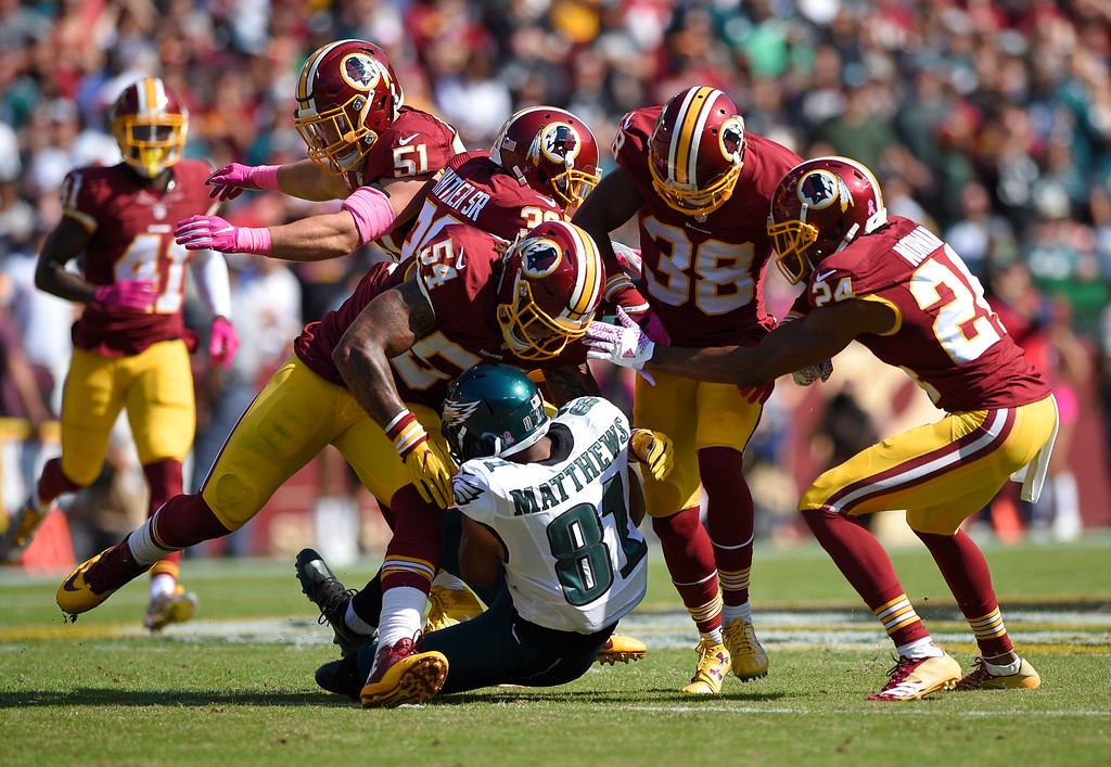 . Washington Redskins defenders tackle Philadelphia Eagles wide receiver Jordan Matthews (81) in the first half of an NFL football game, Sunday, Oct. 16, 2016, in Landover, Md. (AP Photo/Nick Wass)