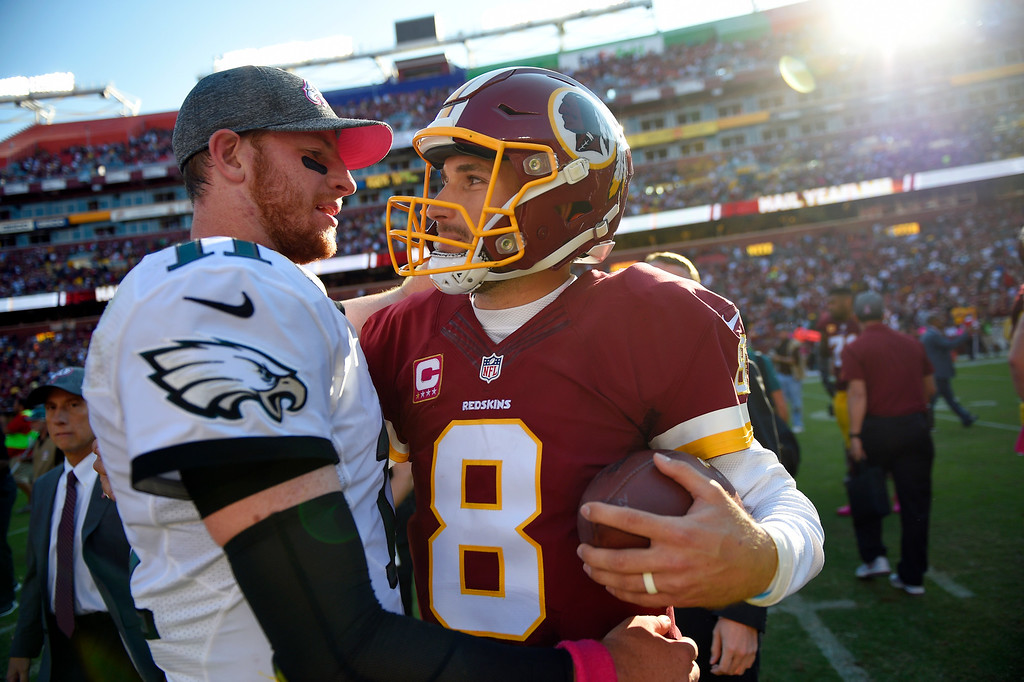 . Philadelphia Eagles quarterback Carson Wentz, left, chats with Washington Redskins quarterback Kirk Cousins after an NFL football game, Sunday, Oct. 16, 2016, in Landover, Md. Washington won 27-20. (AP Photo/Nick Wass)