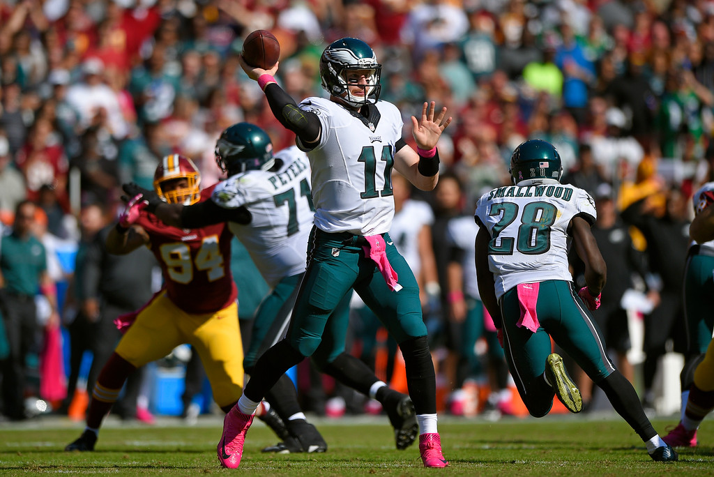 . Philadelphia Eagles quarterback Carson Wentz (11) throws to a receiver in the first half of an NFL football game against the Washington Redskins, Sunday, Oct. 16, 2016, in Landover, Md. (AP Photo/Nick Wass)
