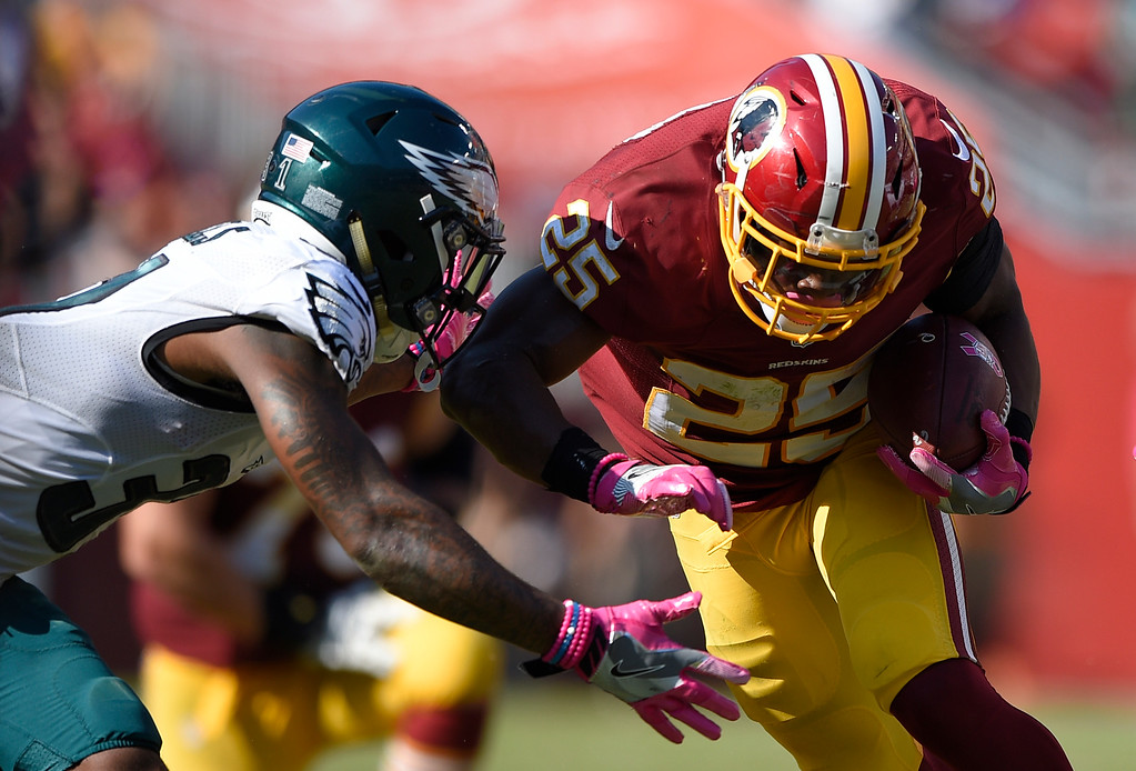 . Philadelphia Eagles free safety Jalen Mills, left, tackles Washington Redskins running back Chris Thompson in the second half of an NFL football game, Sunday, Oct. 16, 2016, in Landover, Md. (AP Photo/Nick Wass)