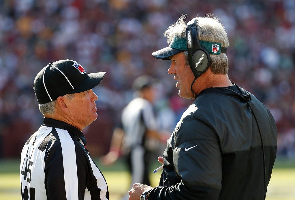 . Line judge Jeff Seeman, left, talks with Philadelphia Eagles head coach Doug Pederson in the second half of an NFL football game against the Washington Redskins, Sunday, Oct. 16, 2016, in Landover, Md. (AP Photo/Alex Brandon)