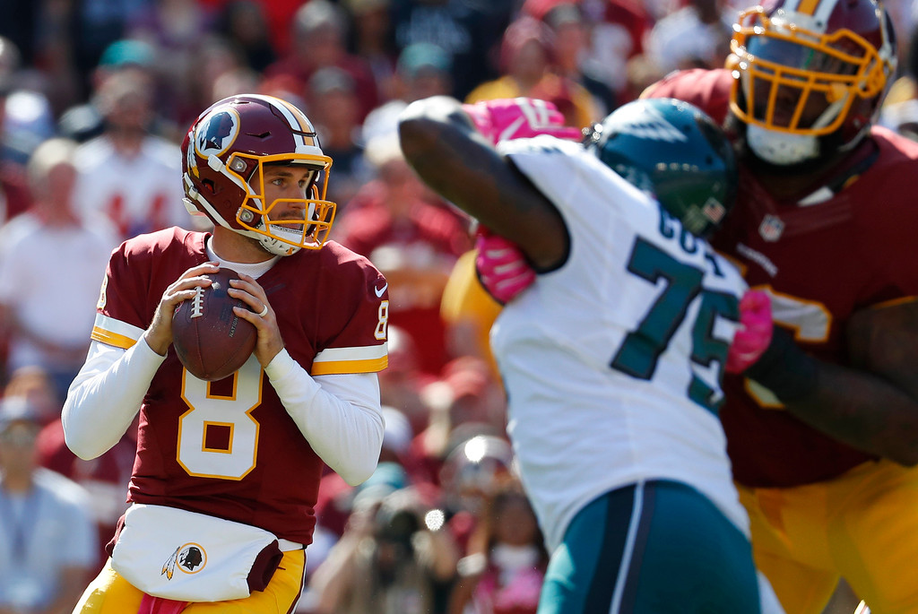 . Washington Redskins quarterback Kirk Cousins throws to a receiver in the first half of an NFL football game against the Philadelphia Eagles, Sunday, Oct. 16, 2016, in Landover, Md. (AP Photo/Alex Brandon)