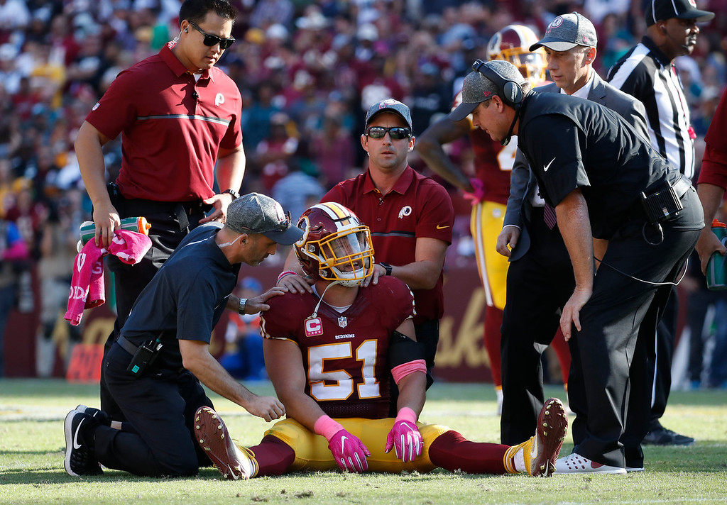 . Washington Redskins inside linebacker Will Compton (51) is tended to in the second half of an NFL football game against the Philadelphia Eagles, Sunday, Oct. 16, 2016, in Landover, Md. (AP Photo/Alex Brandon)