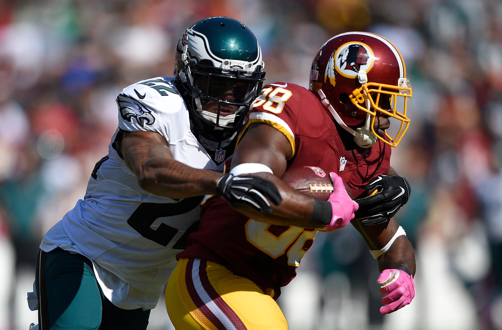 . Philadelphia Eagles cornerback Nolan Carroll, left, tackles Washington Redskins wide receiver Pierre Garcon in the first half of an NFL football game, Sunday, Oct. 16, 2016, in Landover, Md. (AP Photo/Nick Wass)