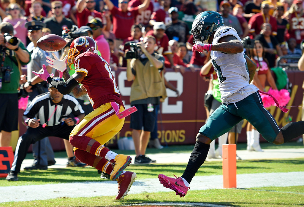 . Washington Redskins wide receiver DeSean Jackson, left, is unable to hold onto a pass attempt in the end zone in front of Philadelphia Eagles free safety Jalen Mills in the first half of an NFL football game, Sunday, Oct. 16, 2016, in Landover, Md. (AP Photo/Nick Wass)