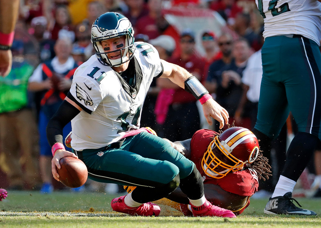 . Philadelphia Eagles quarterback Carson Wentz, left, is sacked by Washington Redskins defensive end Ricky Jean Francois in the second half of an NFL football game, Sunday, Oct. 16, 2016, in Landover, Md. Washington won 27-20. (AP Photo/Alex Brandon)