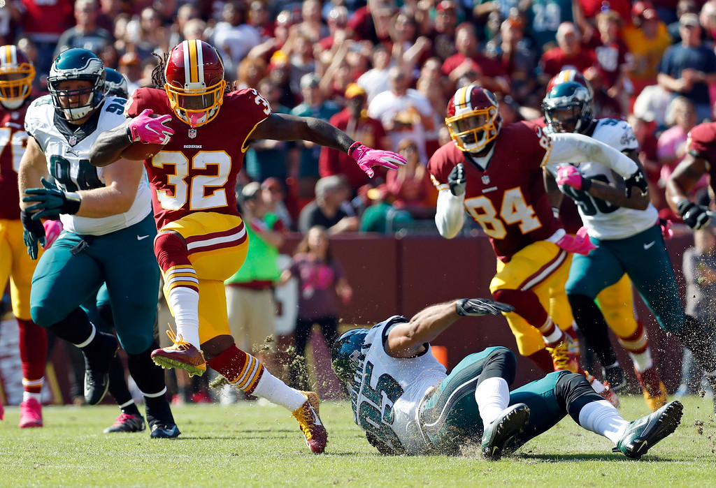 . Washington Redskins running back Rob Kelley (32) rushes past Philadelphia Eagles outside linebacker Mychal Kendricks (95) in the first half of an NFL football game, Sunday, Oct. 16, 2016, in Landover, Md. (AP Photo/Alex Brandon)