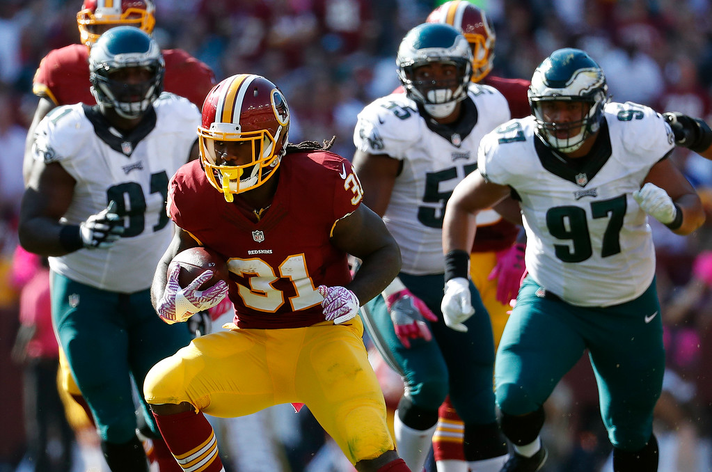 . Washington Redskins running back Matt Jones (31) rushes the ball in the second half of an NFL football game against the Philadelphia Eagles, Sunday, Oct. 16, 2016, in Landover, Md. (AP Photo/Alex Brandon)