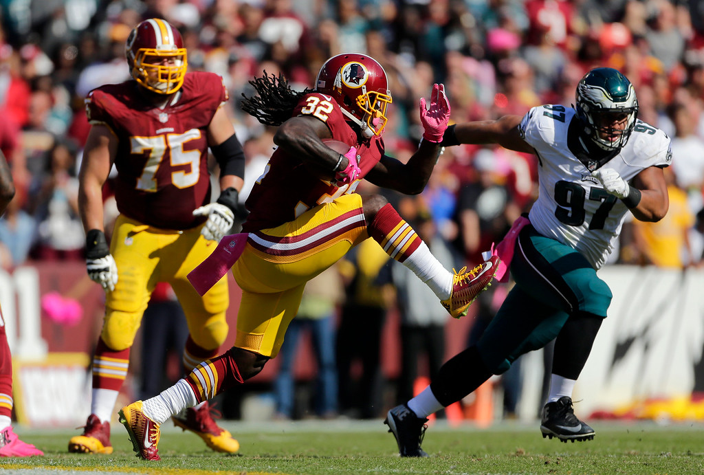 . Washington Redskins running back Rob Kelley (32) rushes the ball in the first half of an NFL football game against the Philadelphia Eagles, Sunday, Oct. 16, 2016, in Landover, Md. (AP Photo/Mark Tenally)
