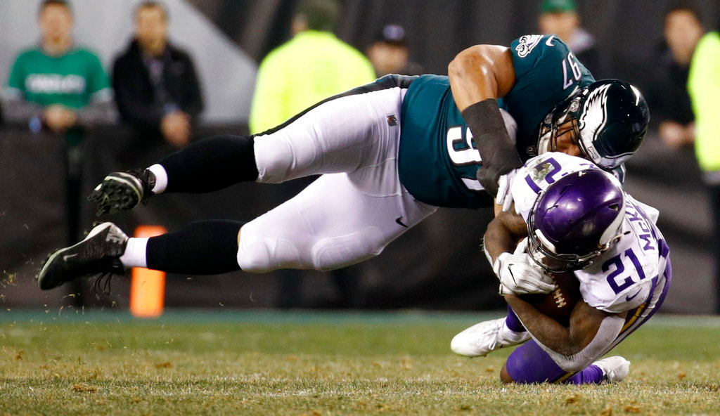. Philadelphia Eagles\' Destiny Vaeao hits Minnesota Vikings\' Jerick McKinnon during the second half of the NFL football NFC championship game Sunday, Jan. 21, 2018, in Philadelphia. (AP Photo/Patrick Semansky)