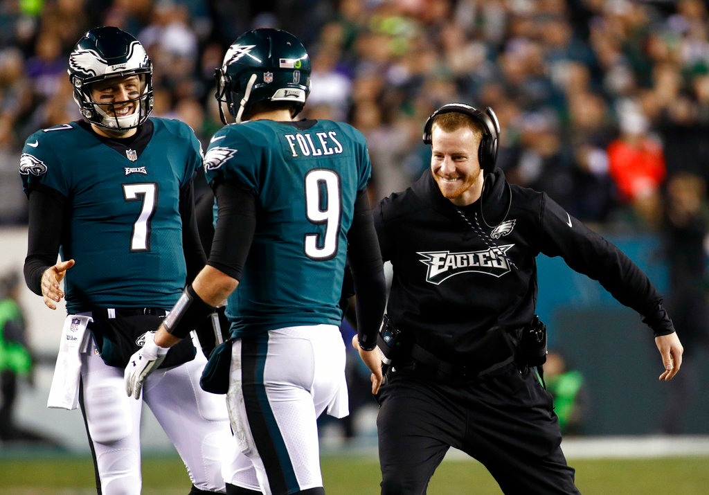 . Philadelphia Eagles\' Carson Wentz congratulates Nick Foles (9) during the second half of the NFL football NFC championship game against the Minnesota Vikings Sunday, Jan. 21, 2018, in Philadelphia. (AP Photo/Patrick Semansky)