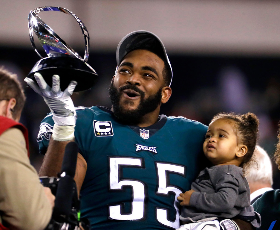 . Philadelphia Eagles\' Brandon Graham holds the George Halas Trophy after the NFL football NFC championship game against the Minnesota Vikings Sunday, Jan. 21, 2018, in Philadelphia. The Eagles won 38-7 to advance to Super Bowl LII. (AP Photo/Michael Perez)