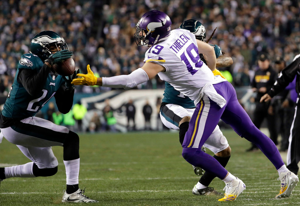 . Philadelphia Eagles\' Corey Graham intercepts a pass in front of Minnesota Vikings\' Adam Thielen during the second half of the NFL football NFC championship game Sunday, Jan. 21, 2018, in Philadelphia. (AP Photo/Matt Slocum)