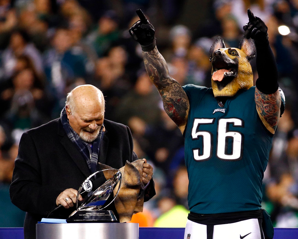 . Philadelphia Eagles\' Chris Long wears a mask after the NFL football NFC championship game against the Minnesota Vikings Sunday, Jan. 21, 2018, in Philadelphia. The Eagles won 38-7 to advance to Super Bowl LII. (AP Photo/Patrick Semansky)