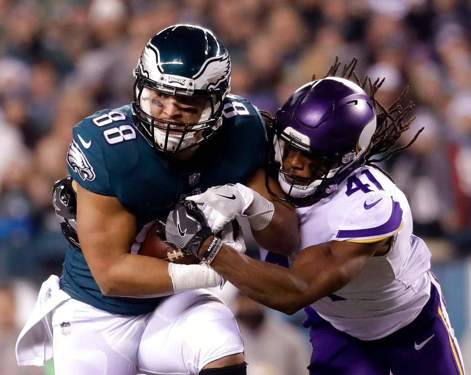 . Philadelphia Eagles\' Trey Burton catches a pass in front of Minnesota Vikings\' Anthony Harris during the second half of the NFL football NFC championship game Sunday, Jan. 21, 2018, in Philadelphia. (AP Photo/Michael Perez)