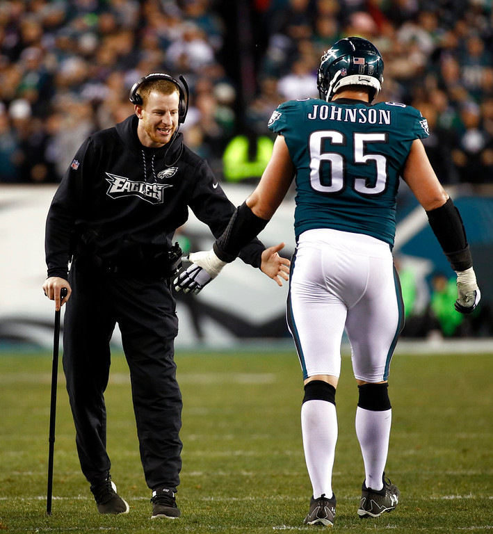 . Philadelphia Eagles\' Carson Wentz congratulates Lane Johnson during the second half of the NFL football NFC championship game against the Minnesota Vikings Sunday, Jan. 21, 2018, in Philadelphia. (AP Photo/Patrick Semansky)