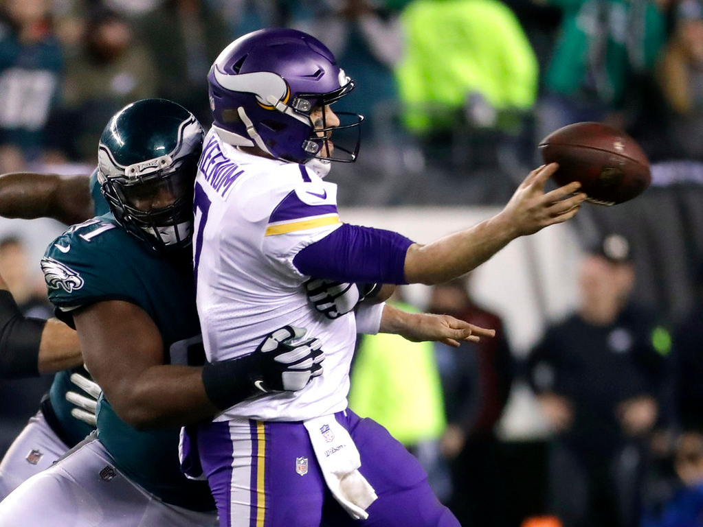 . Philadelphia Eagles\' Fletcher Cox hits Minnesota Vikings\' Case Keenum as he throws during the second half of the NFL football NFC championship game Sunday, Jan. 21, 2018, in Philadelphia. (AP Photo/Michael Perez)