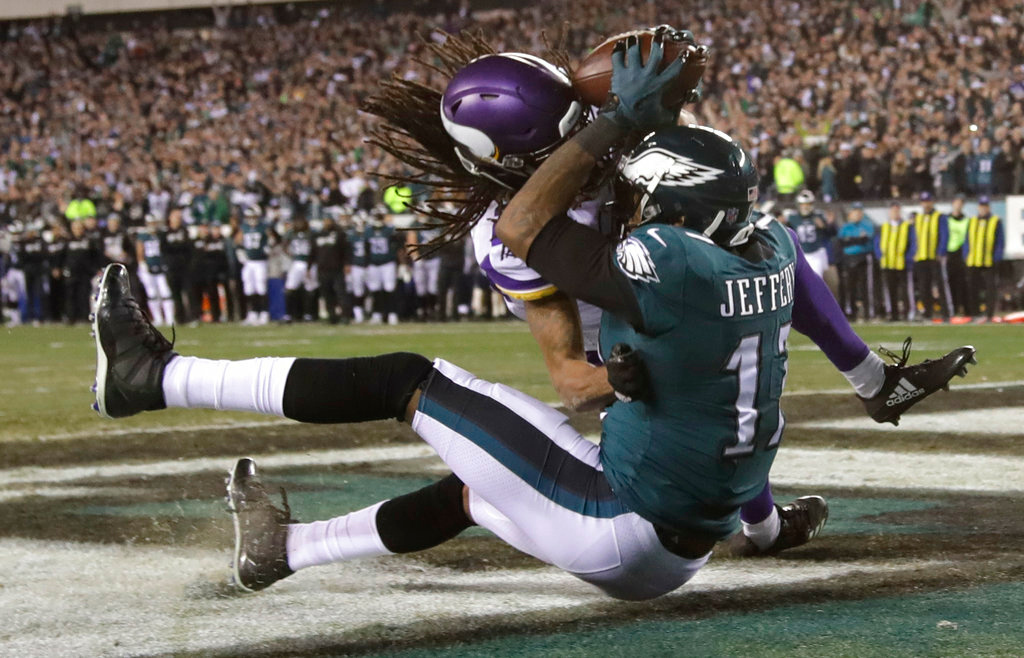 . Philadelphia Eagles\' Alshon Jeffery catches a touchdown pass during the second half of the NFL football NFC championship game against the Minnesota Vikings Sunday, Jan. 21, 2018, in Philadelphia. (AP Photo/Matt Rourke)
