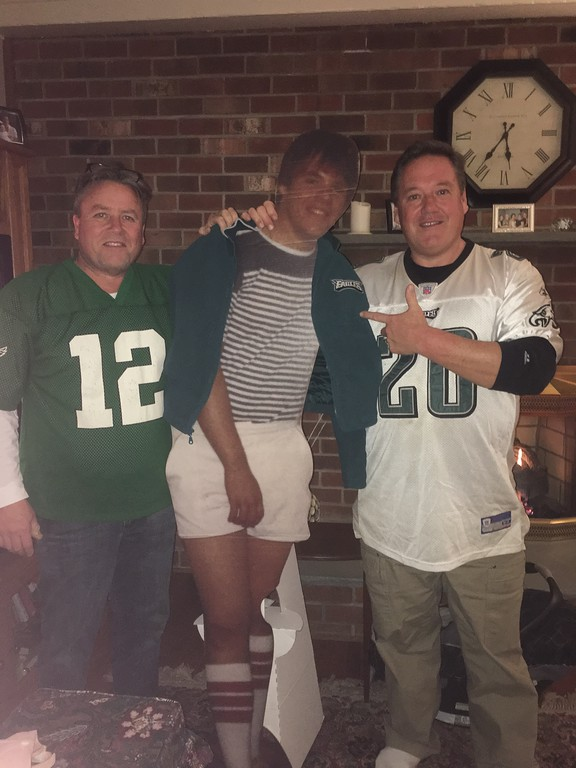 . PJ and Jimmy Sweeney celebrating in Newtown Square with a cardboard cutout of their youngest brother Michael sweeney who moved to Massachusetts.