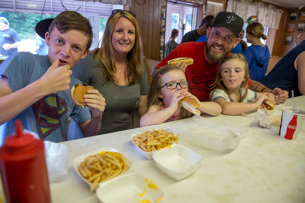 . RICK KAUFFMAN - DIGITAL FIRST MEDIA Traveling from their home in Stafford, Va., the Sinnott family, originally from Linwood, made the trip up to get hot dogs and hamburgers from John�s Doggie Shop one final time. From left: Josh, 11; Jamie; Mollie, 4; Duffy; and Ella, 5.