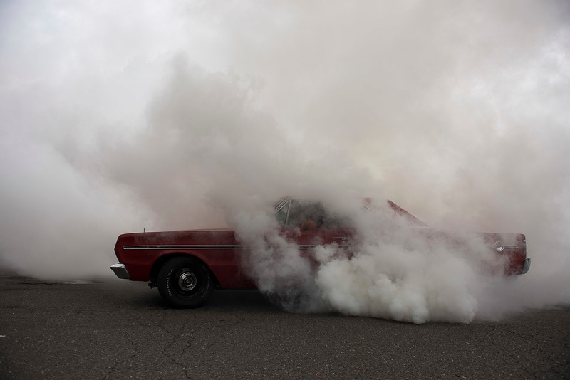 RICK KAUFFMAN - DIGITAL FIRST MEDIA <br /> A 1966 Plymouth Belvedere erupts a cloud of smoke outside John's Doggie Shop on Saturday, the final day of business after 69 years.
