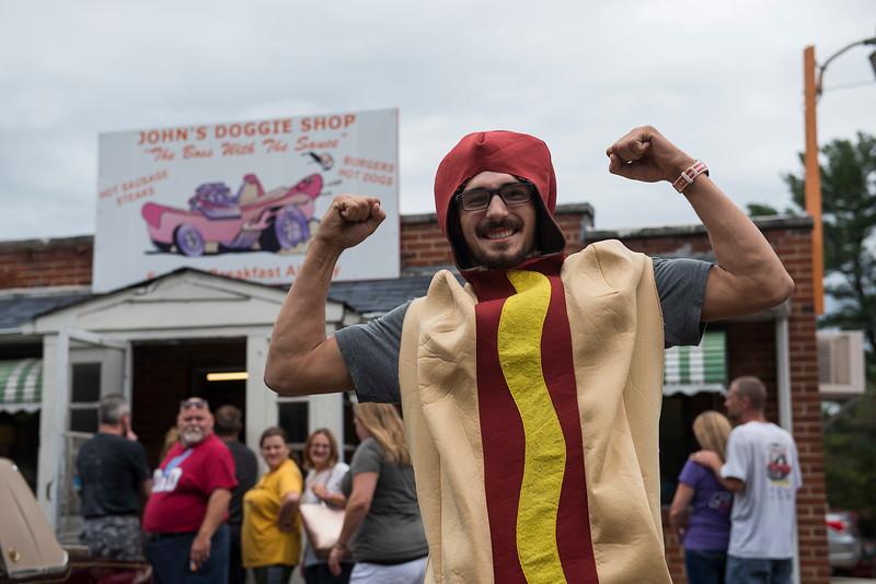 RICK KAUFFMAN - DIGITAL FIRST MEDIA <br /> Yianni Eleutheriou, nephew of owner George Eleutheriou, poses in hot dog costume outside John's Doggie Shop in Upper Chichester on their final day of business Saturday.