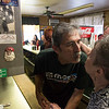 "RICK KAUFFMAN - DIGITAL FIRST MEDIA <br /> John's Doggie Shop owner George Eleutheriou, left, gives a kiss to long-time family friend, Maureen DeLong, right, who said the close of the shop on Saturday for good was ""a sad day."""