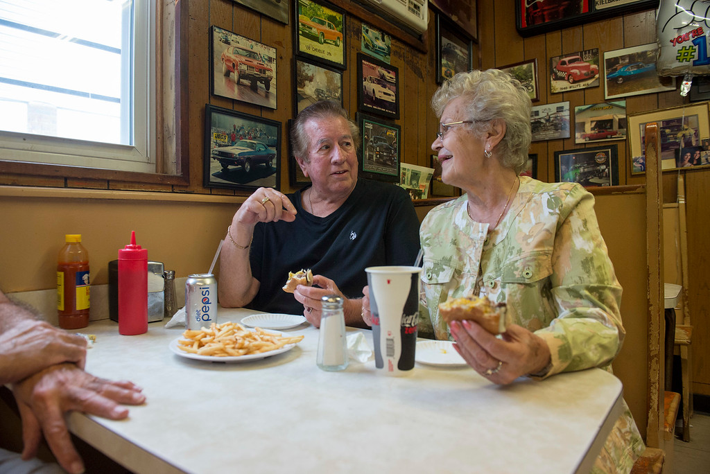 . RICK KAUFFMAN - DIGITAL FIRST MEDIA Jean Francis, right, said she met Pete Eleutheriou when they were in the third grade and have remained friends every since. She and husband, Rich Francis, left, reminisced with Eleutheriou over cheeseburgers Saturday.