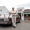RICK KAUFFMAN - DIGITAL FIRST MEDIA <br /> Pete Eleutheriou poses with his 1987 Cadillac DeVille outside his son's business, John's Doggie Shop, which began under Pete's father 69 years earlier.
