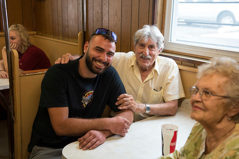 RICK KAUFFMAN - DIGITAL FIRST MEDIA <br /> Pete Eleutherious, right, sits with nephew John Sitares, left, as long-time patrons and family members came to enjoy John's Doggie Shop one final time along 322.