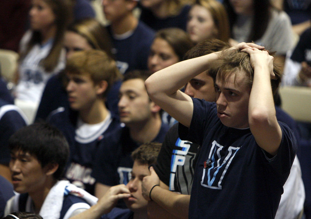 . Villanova freshman Pete Rechter reacts while watching the Wildcats play North Carolina in the NCAA Final Four college basketball tournament during a watch party in Villanova,  Pa., on Saturday April 4, 2009.  (AP Photo/ Joseph Kaczmarek)
