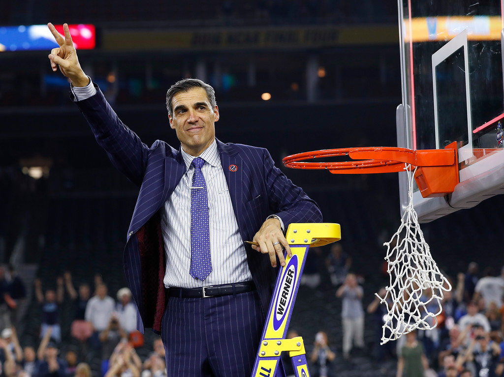 . Villanova head coach Jay Wright waved to fans after the NCAA Final Four tournament college basketball championship game against North Carolina, Monday, April 4, 2016, in Houston. Villanova won 77-74. (AP Photo/David J. Phillip)