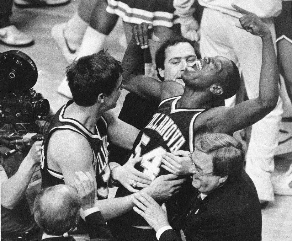 . FILE - In this April 1, 1985 file photo, Villanova\'s Ed Pinckney (54) yells out as he is surrounded by teammates after the Wildcats defeated Georgetown for the national championship in the Final Four of the NCAA college basketball tournament in Lexington, Ky. (AP Photo/Gary Landers, File)