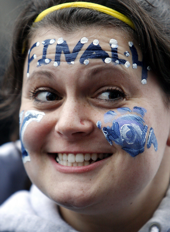 . Villanova fan Lisa D\'Annunzio wears face paint at a rally outside the Pavilion in Villanova, Pa., on Wednesday, April 1, 2009, as the Villanova team departs for the men\'s NCAA college basketball tournament Final Four. Villanova takes on North Carolina in the national semifinals on Saturday in Detroit. (AP Photo/ Joseph Kaczmarek)