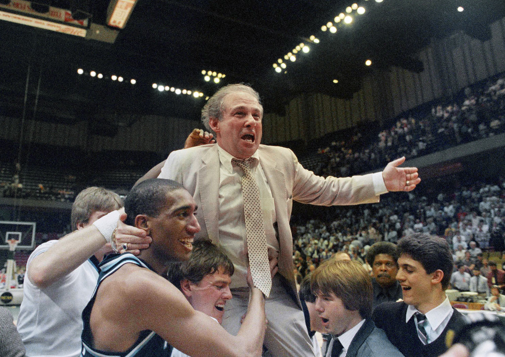 . FILE - In this March 24, 1985 file photo, Villanova coach Rollie Massimino takes a victory ride on his players shoulders. Rollie Massimino, who led Villanova\'s storied run to the 1985 NCAA championship and won more than 800 games in his career, died Wednesday, Aug. 30, 2017 after a long battle with cancer. He was 82. (AP Photo/File)