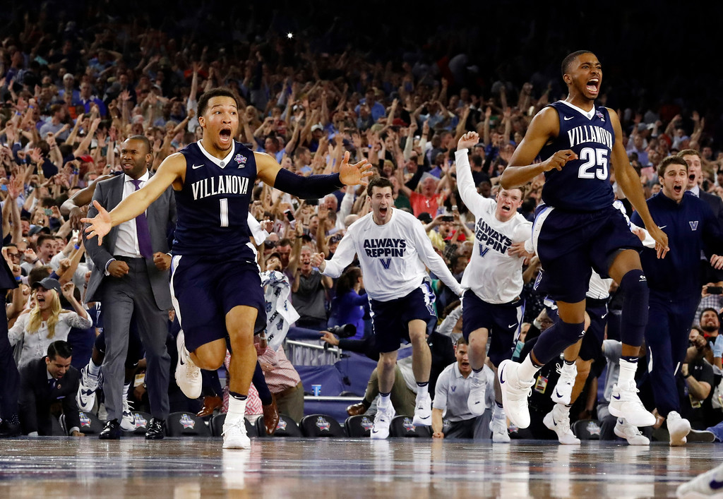 . Villanova\'s Jalen Brunson (1), Mikal Bridges (25) and their teammates celebrate after the NCAA Final Four tournament college basketball championship game against North Carolina, Monday, April 4, 2016, in Houston. Villanova won 77-74. (AP Photo/David J. Phillip)