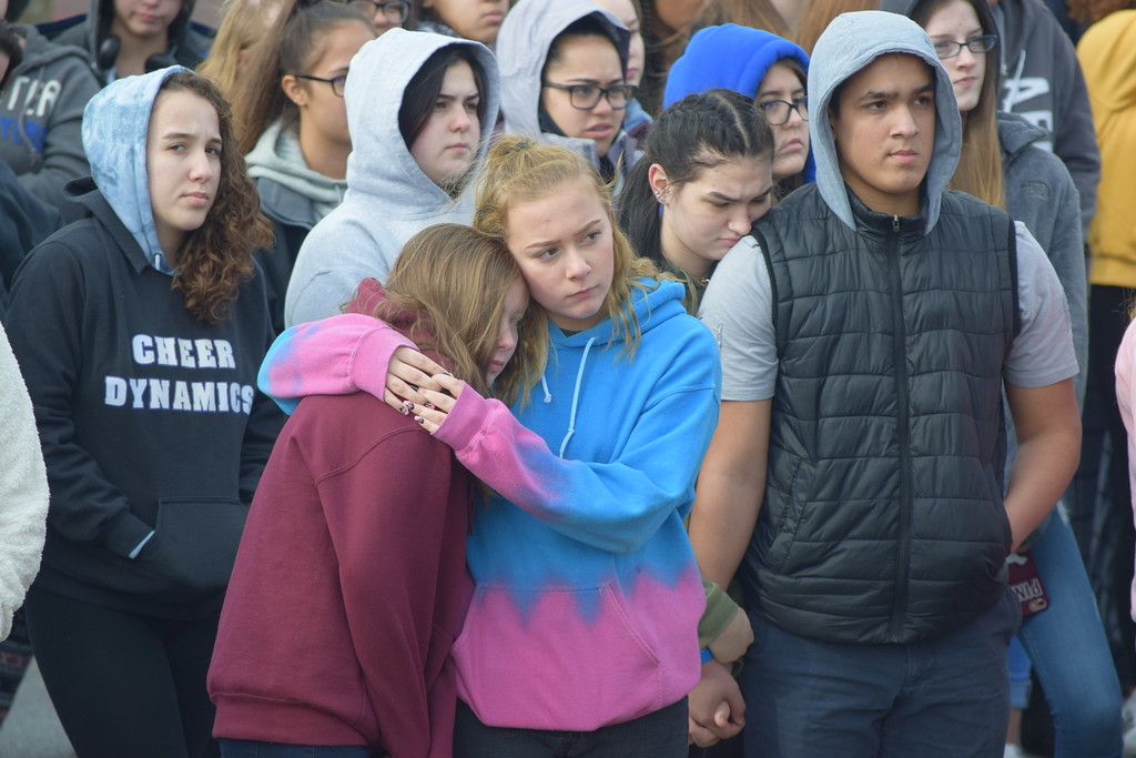 . Students at Pottsgrove High School held hands and hugged as student leaders read aloud the names of the 17 victims of the Marjory Stoneman Douglas High School shooting.  Photo by Marian Dennis