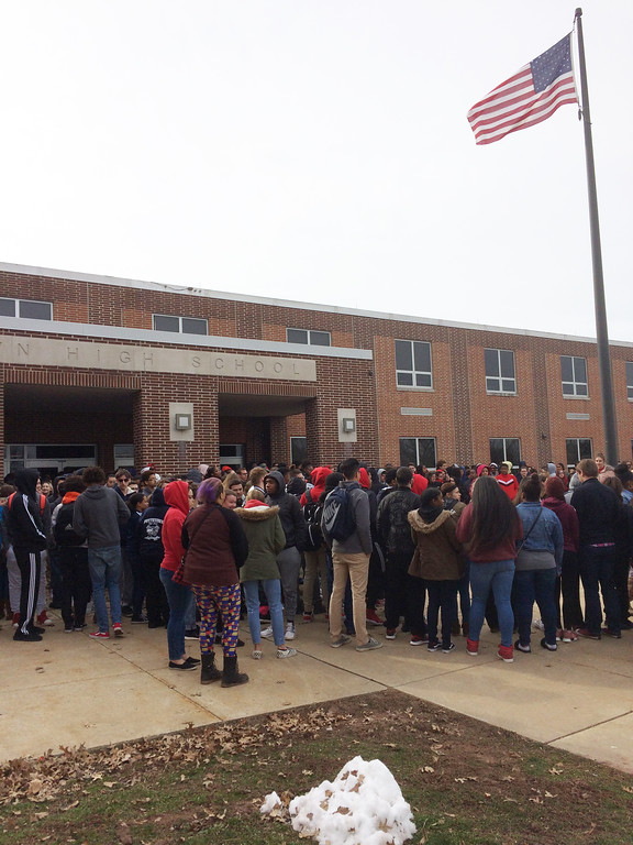 . Evan Brandt -- Digital First Media Pottstown High School students gathered around the flagpole in front of the school for their walk-out Wednesday in recognition of those who  died in the shootings at Marjorie Stoneman Douglas High School in Parkland Florida Feb. 14.