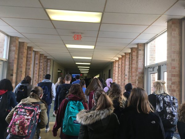 . North Penn High School students walk out. Photo by Dan Sokil