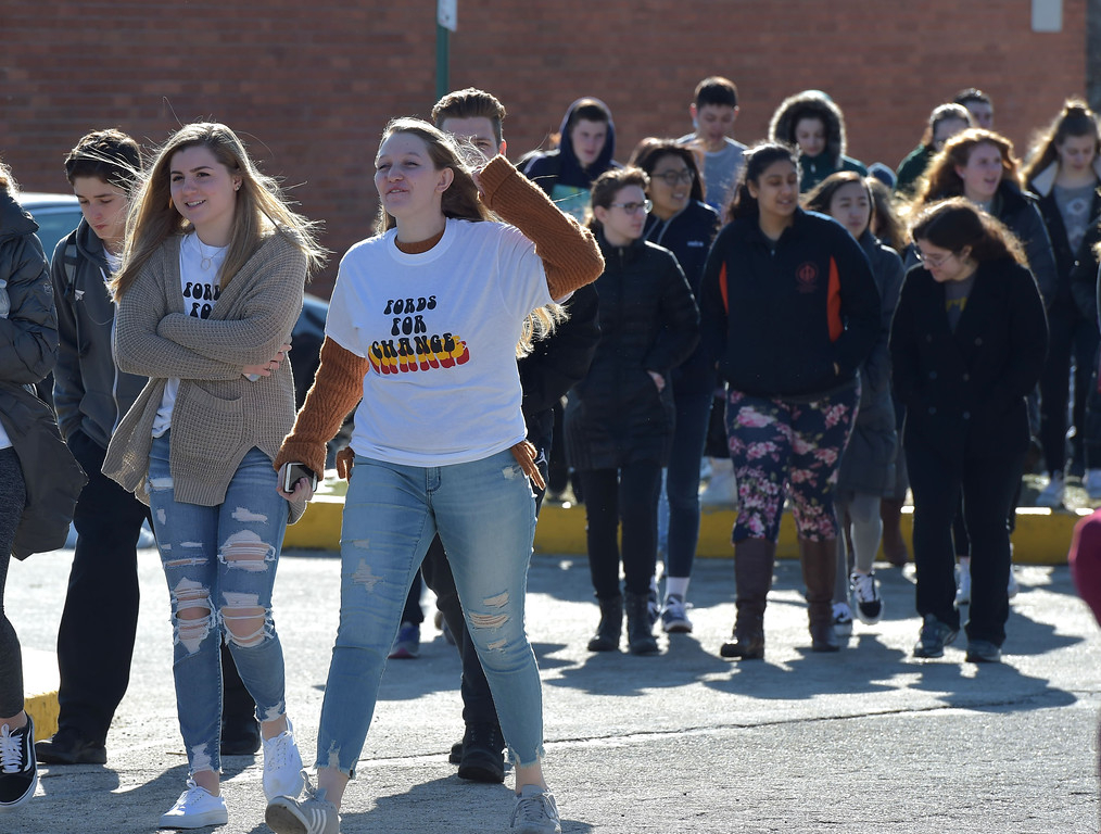 . PETE  BANNAN-DIGITAL FIRST MEDIA       Haverford High School students walks out of  school to the Student Unity Rally held at Cornog Field Wednesday morning.  School officials estimated over 900 students took part, including walking  around the track 17 times to remember the students killed in the Florida school shooting. They then held speeches and music before returning to classes. School officials said students organized the event while working with the administration.
