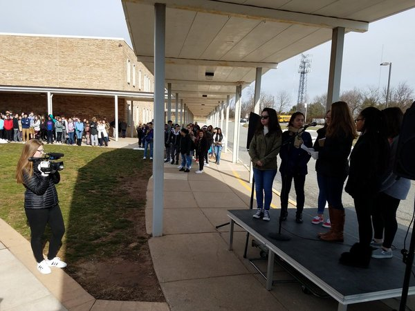 . North Penn High School students reading the names of Florida shooting victims at school courtyard - a solemn silence as names are read and @NPTV students are recording the ceremony. Photo by Dan Sokil