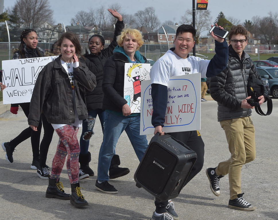 . PETE  BANNAN-DIGITAL FIRST     Haverford High School students return from their Student Unity Rally held at Cornog Field Wednesday morning.  School officials estimated over 900 students took part, they walked arounfd the track 17 times to remember the students killed in the Florida school shooting then held speeches and music before returning to classes. School officials said the students organized the event while working with the administration.