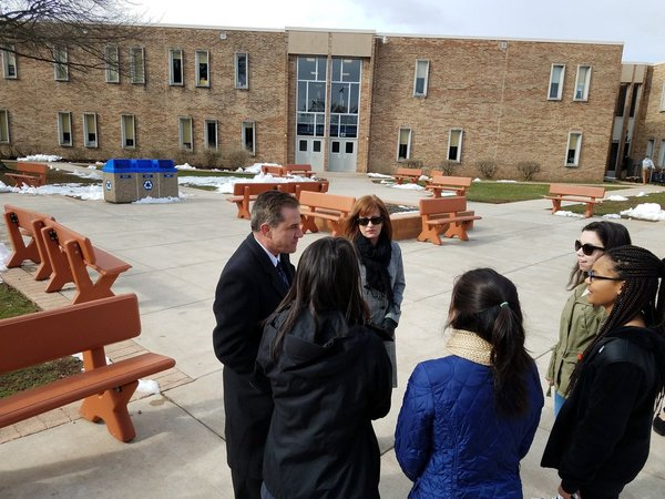 . North Penn Superintendent and school board president talking to student organizers. Photo by Dan Sokil