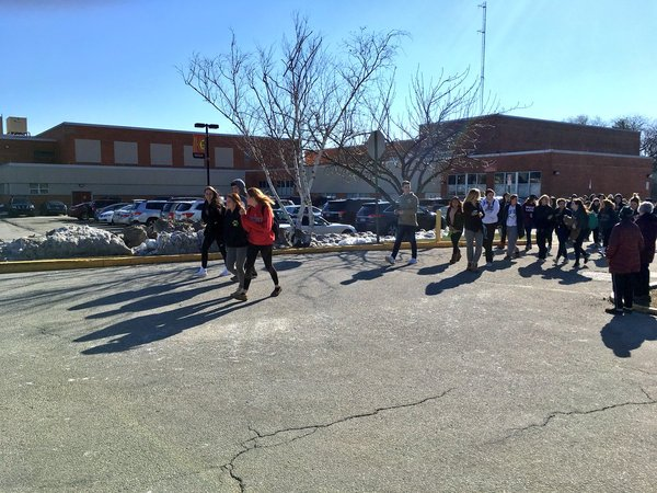 . Haverford students chanting �no more gun violence� as they walk around track.  Photo by Pete Bannan
