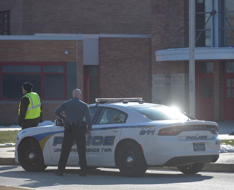 . PETE  BANNAN-DIGITAL FIRST MEDIA      A Upper Providence police officer outside Penncrest High School Wednesday morning.  The campus was clsed during the student walkout.