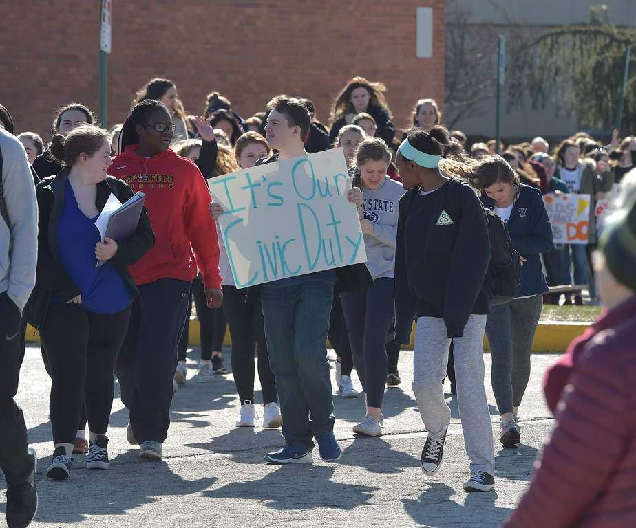. PETE  BANNAN-DIGITAL FIRST MEDIA      Haverford High School students walk out of school to the Student Unity Rally held at Cornog Field Wednesday morning.  School officials estimated over 900 students took part, including walking  around the track 17 times to remember the students killed in the Florida school shooting. They then held speeches and music before returning to classes. School officials said students organized the event while working with the administration.