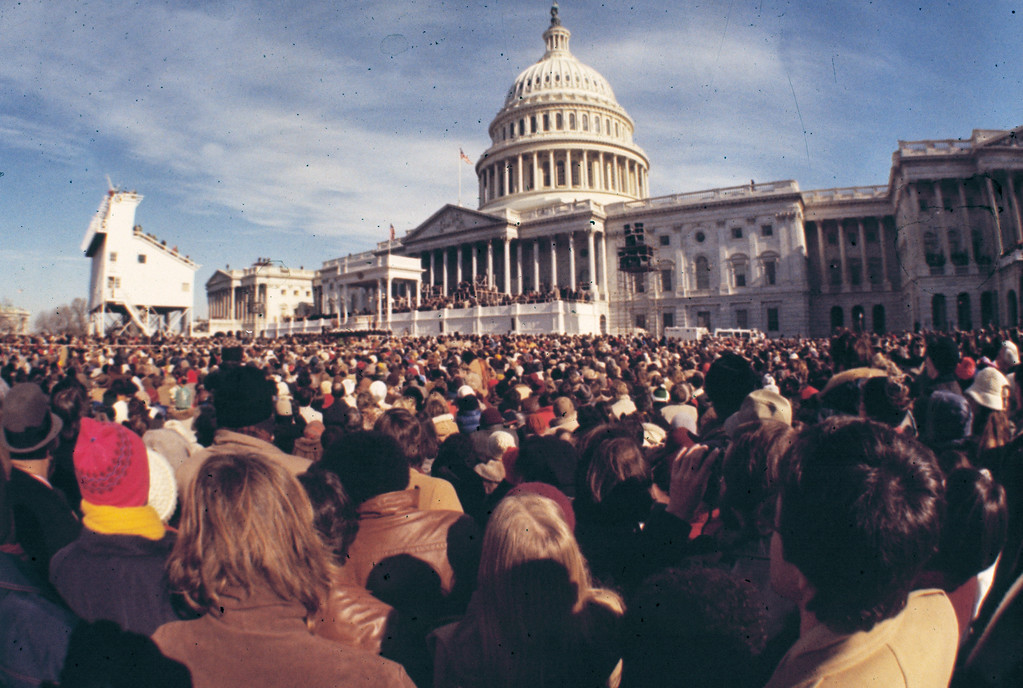 . This is a general view of the crowd gathered outside the U.S. Capitol for the inauguration of President-elect Jimmy Carter as he is sworn in as the 39th president of the United States in Washington, D.C., Jan. 20, 1977.   (AP Photo)