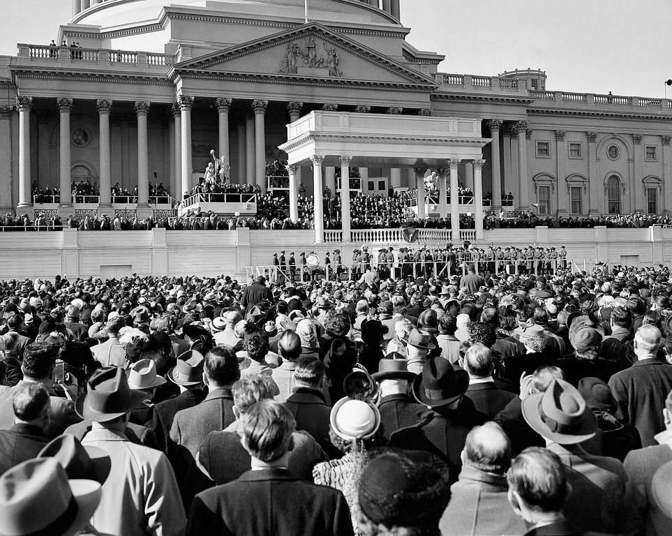 . The Capitol formed the backdrop as President Harry Truman delivered his inaugural address, Jan. 20, 1949, from the Portico at center after being sworn into office. In foreground is part of crowd which filled Capitol Plaza. (AP Photo)