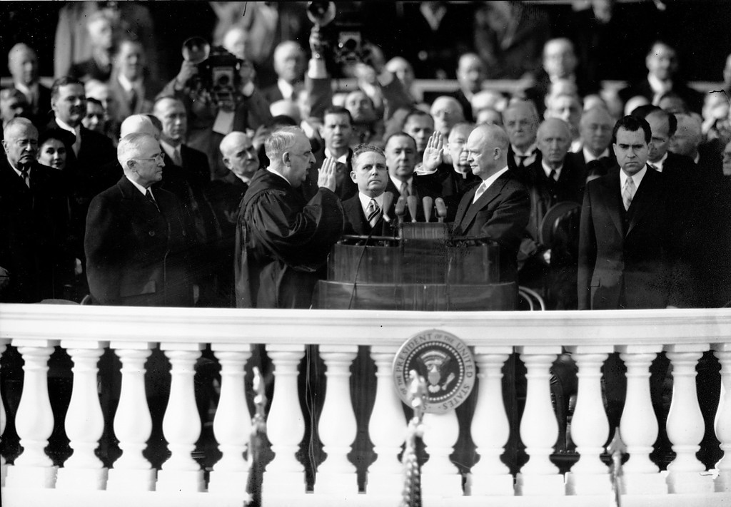 . Dwight D. Eisenhower is inaugurated as U.S. President as U.S. Chief Justice Fred Vinson administers the oath of office during the capitol ceremony in Washington D.C. on Jan. 20, 1953.  Richard Nixon, the new U.S. Vice President is standing on the right.  (AP Photo)
